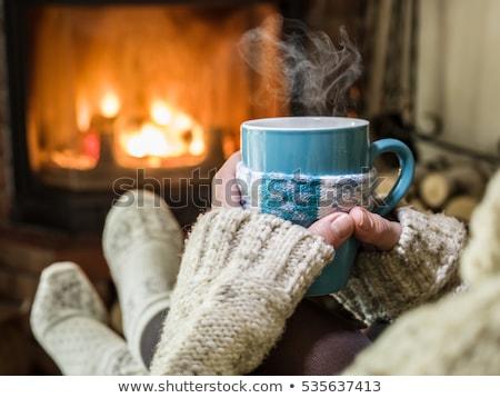 invierno · casa · chimenea · mujer · beber · caliente - foto stock © candyboxphoto
