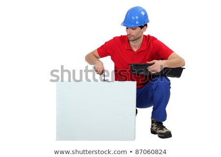 Bricklayer cementing a board left blank for your message Stock photo © photography33