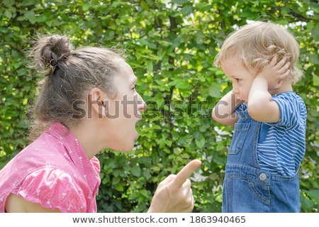 Photo of a boy with his fingers in his ears.  Stock photo © dacasdo