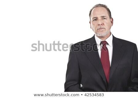Portrait of an older businessman listening. Stock photo © HASLOO