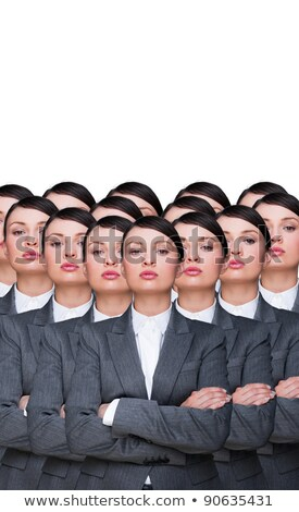 Many identical businesswomen clones. Businesswoman production co Stock photo © HASLOO