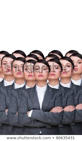 Beaucoup identique affaires femme d'affaires production armée Photo stock © HASLOO