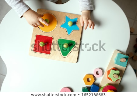 Happy boy playing frame construction. stock photo © justinb