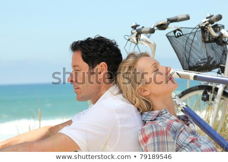 Couple alseep with bikes by the sea Stock photo © photography33