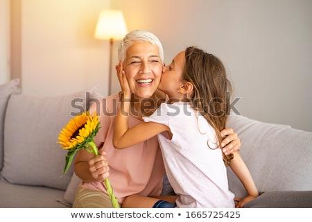 Dziewczyna mum kiss miłości laptop portret Zdjęcia stock © photography33