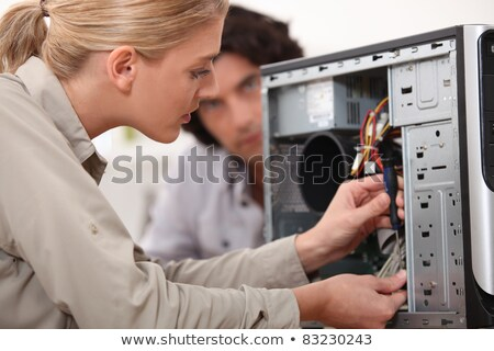 woman fixing a computer hard drive stock photo © photography33