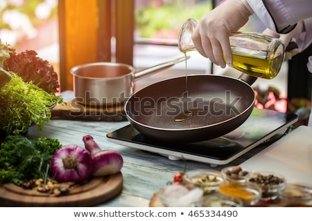 black chef with frying pan Stock photo © photography33