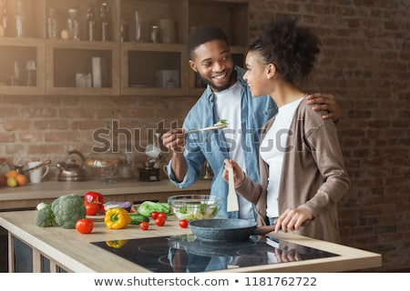 couple laughing in the kitchen Stock photo © photography33