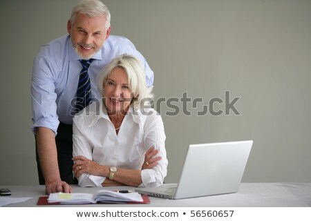 Senior couple in suit in front of a laptop computer Stock photo © photography33