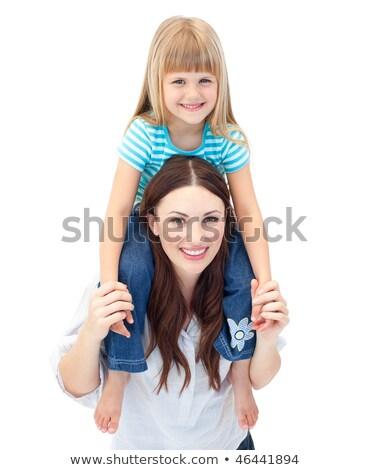 Cheerful brunette mother giving her daughter piggyback ride Stock photo © wavebreak_media