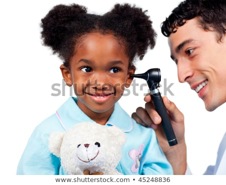 Afro-american doctor attending a male patient stock photo © wavebreak_media