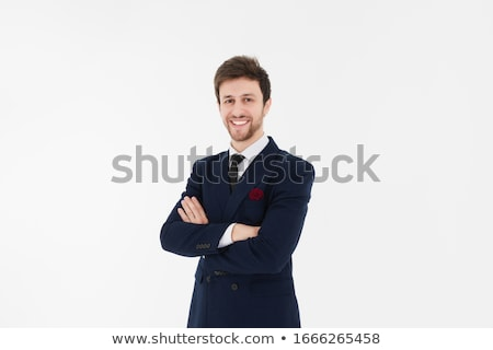 Handsome smiling businessman with folded arms stock photo © wavebreak_media