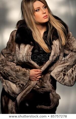 Nice · молодые · блондинка · шуба · черный · джинсов - Сток-фото © acidgrey
