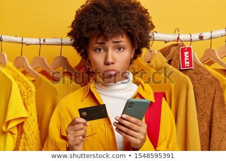 Nő áll mögött ruhaakasztó bolt kéz Stock fotó © wavebreak_media