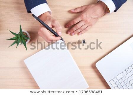 Businessman Writes, Above Stock photo © jackethead