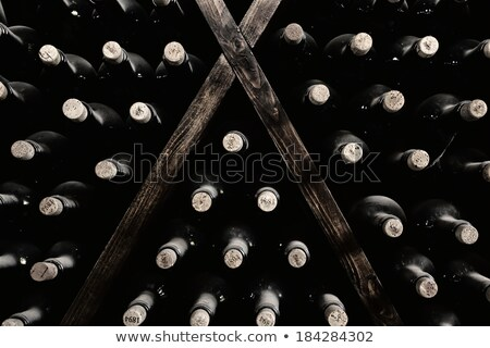 wine bottles stacked up stock photo © kubais