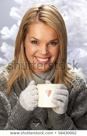 Young Woman Drinking Hot Drink Wearing Knitwear In Studio In Fro Stock photo © monkey_business