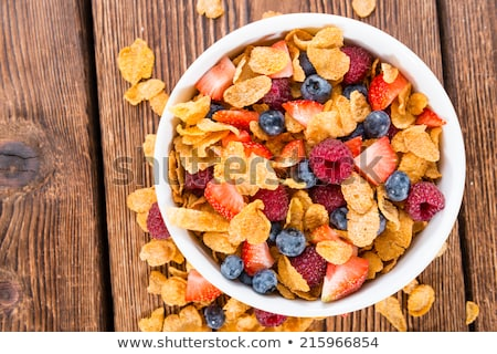Corn flakes and berry fruit Stock photo © badmanproduction