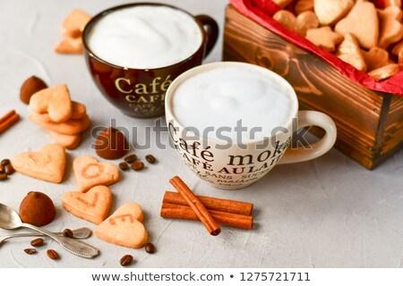 Dos grande chocolate cookies taza café negro Foto stock © raphotos