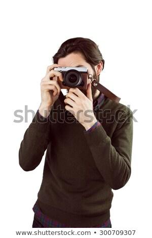 Foto stock: Handsome Hipster Using Vintage Camera
