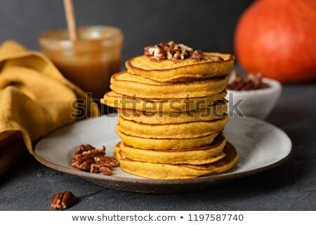Pumpkin pancakes, pecans, and coffee. Stock photo © rojoimages