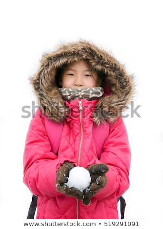Cute girl with furry jacket on white background Stock photo © BigKnell