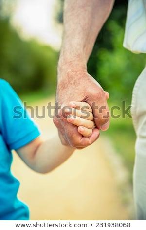 grand-père · petit-enfant · mains · bébé · sourire · visage - photo stock © Paha_L