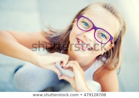 Portrait of a young kid with braces Stock photo © zurijeta