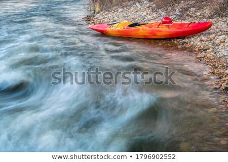kayaking helmet on kayak deck stock photo © pixelsaway