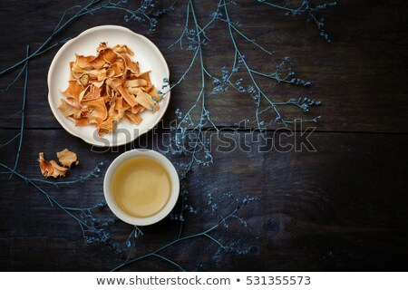 Tea with  lemon and dried flowers on the table Stock photo © master1305