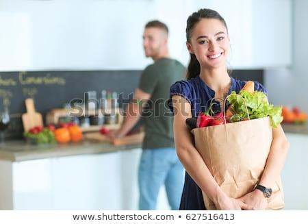 Fiatal érzelmes nő papírzacskó fiatal nő bevásárlószatyor Stock fotó © user_9834712