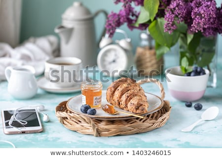croissants · jam · beker · koffie · ontbijt · houten · tafel - stockfoto © filipw