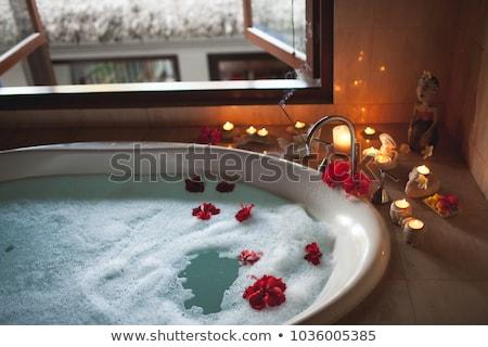 Nő fürdőkád gyönyörű nő szirmok rózsa meztelen Stock fotó © ssuaphoto