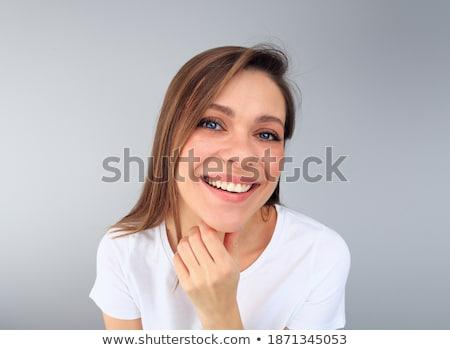 довольно девушки подбородок рук Сток-фото © rcarner