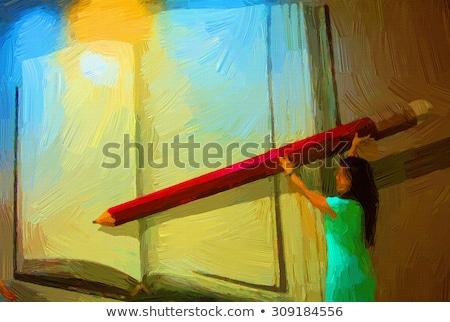 Woman painting in drawing book Stock photo © wavebreak_media