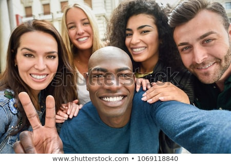 friends taking photo at camera Stock photo © LightFieldStudios