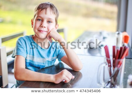 A boy waiting for his food smiling. Stock photo © IS2