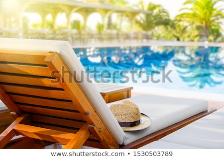 Straw hat on deck chair by the swimming pool Stock photo © stevanovicigor
