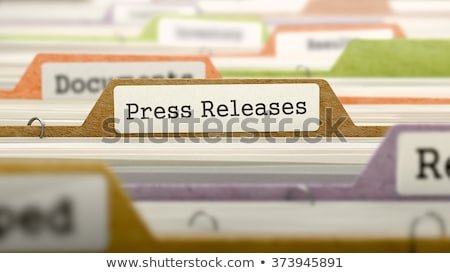 press releases on business folder in catalog stock photo © tashatuvango