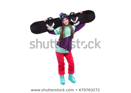 young woman in purple ski outfit hold snowboard on sholders stock photo © traimak