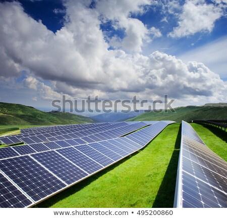 Сток-фото: солнечной · батареи · власти · зеленая · трава · Blue · Sky · ярко