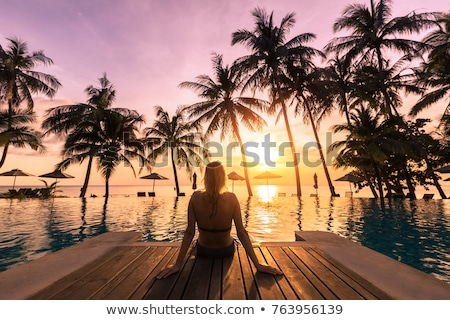 Menina praia nascer do sol em pé belo Foto stock © Kotenko