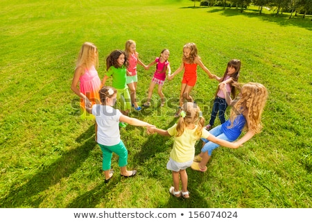 Girls holding hands dancing in a circle Stock photo © IS2