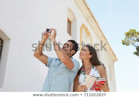 Tourist couple taking snapshot of church Stock photo © IS2