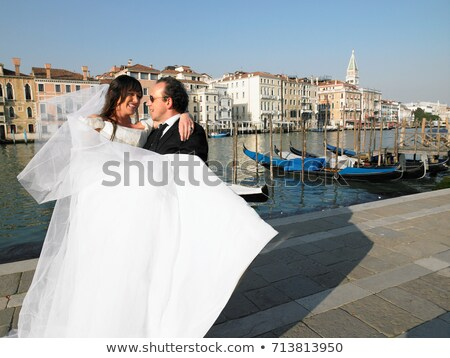 Groom carrying bride. Grand Canal Stock photo © IS2