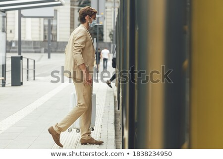 View of businessman waiting for tram Stock photo © IS2