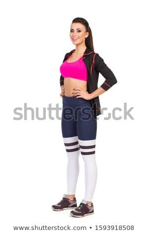 Stock fotó: Mosolyog · fitnessz · nő · áll · kezek · csípők · fehér