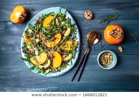Green Pumpkin, persimmons and ingredients for tasty vegetarian c stock photo © artsvitlyna