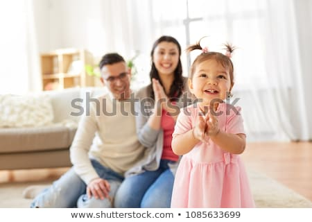 baby girl with parents clapping hands at home Stock photo © dolgachov