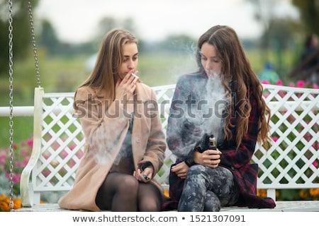 bad teenager smoking cigarette stock photo © bluering